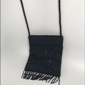 Handbags - Cute black beaded evening bag with a long strap.